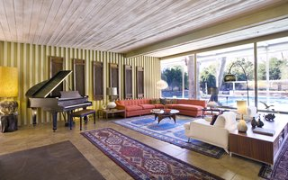 A Luminous Palm Springs Midcentury Asks $3.35M - Photo 3 of 16 - Interiors feature Williams' iconic architectural details, including natural teak wood paneling, built-ins, wood ceilings, slump stone walls and fireplace, clerestory windows, board-and-batten redwood siding, and many original fixtures.