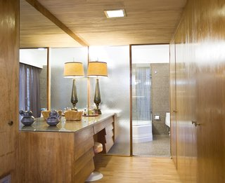 The home featuresoriginal built-in pieces that enhance the midcentury vibe.