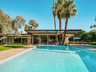 A Luminous Palm Springs Midcentury Asks $3.35M - Photo 11 of 16 - The large L-shaped estate looks out on a large pool and a luxurious outdoor area perfect for entertaining.
