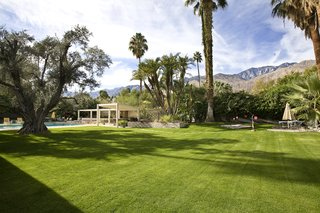 The expansive grassy lawnfeatures several ponds, fountains, native greenery, and even a tea house.