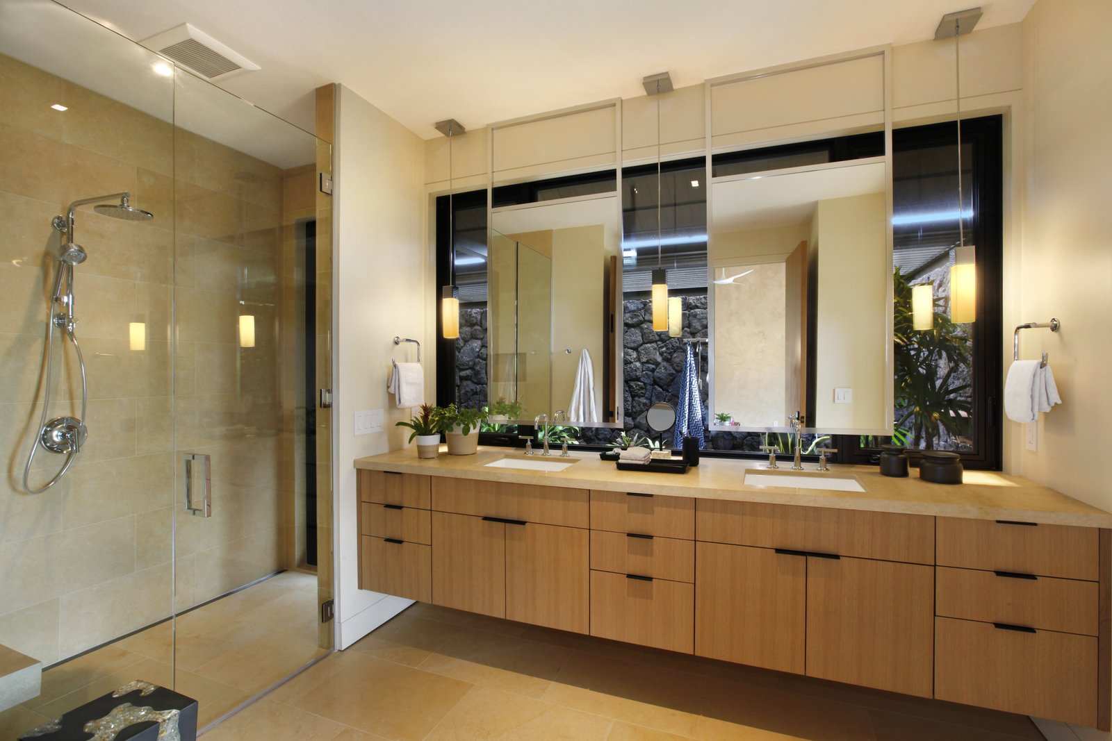 Bath, Drop In, Enclosed, Travertine, and Granite T  Bath Granite Travertine Photos from A Breezy Hawaiian Residence by Olson Kundig Hits the Market at $6.95M