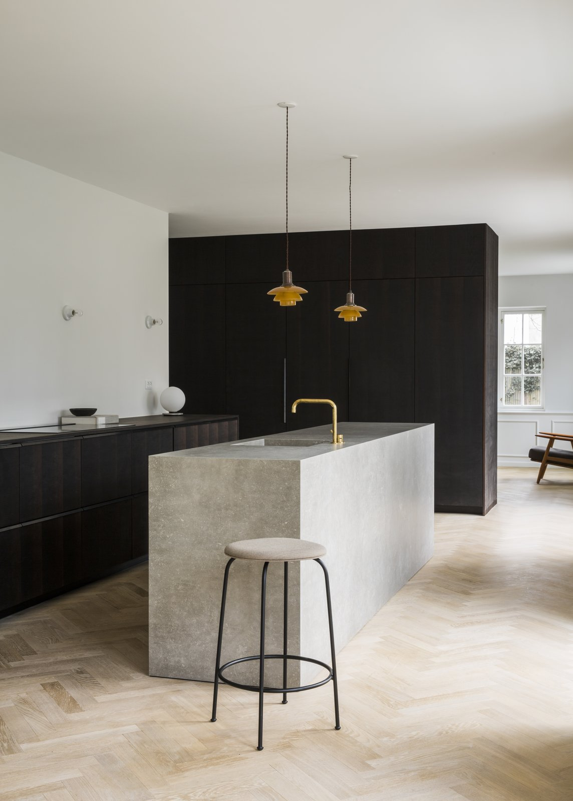 Kitchen, Drop In, Pendant, Stone, Wood, Table, Cooktops, Light Hardwood, and Wall  Best Kitchen Table Wood Photos from The Historic Villa Once Home to Poul Henningsen Receives a Modern Renovation