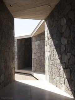 The diagonal patios and sloping roof create angular shadows.