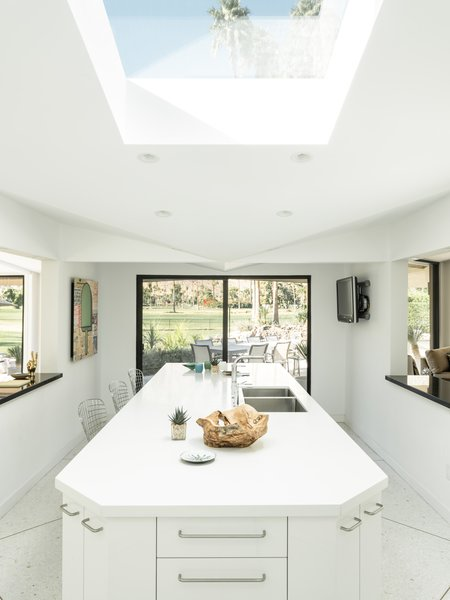 Kitchen, Terrazzo Floor, White Cabinet, Recessed Lighting, and Undermount Sink The kitchen is super bright and airy thanks f  Photo 13 of 19 in Own William Krisel's Palm Springs Pod House For $2.5M