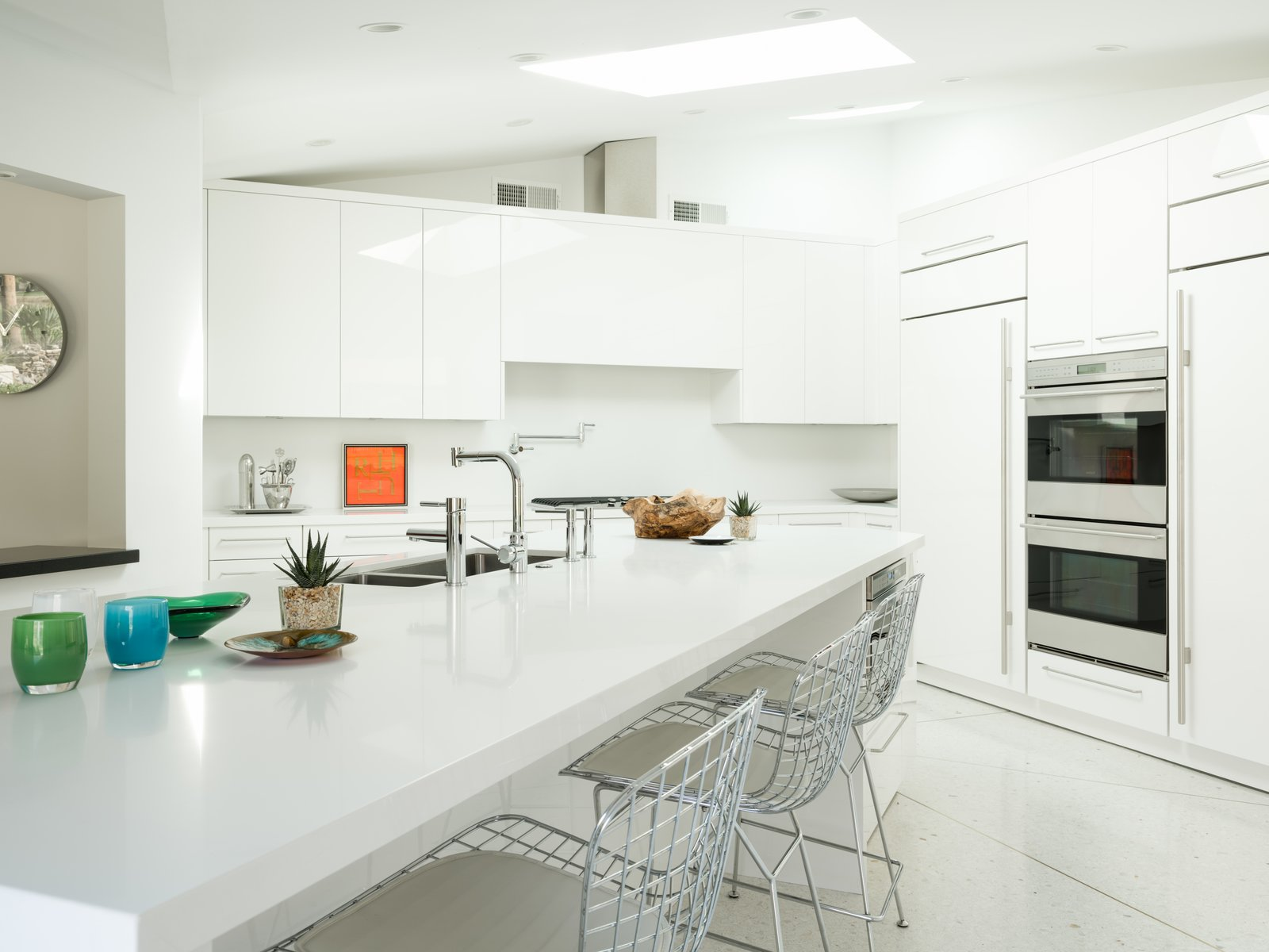 Kitchen, Terrazzo Floor, Refrigerator, White Cabinet, Wall Oven, Undermount Sink, Recessed Lighting, and Range The kitchen.  Photo 14 of 19 in Own William Krisel's Palm Springs Pod House For $2.5M