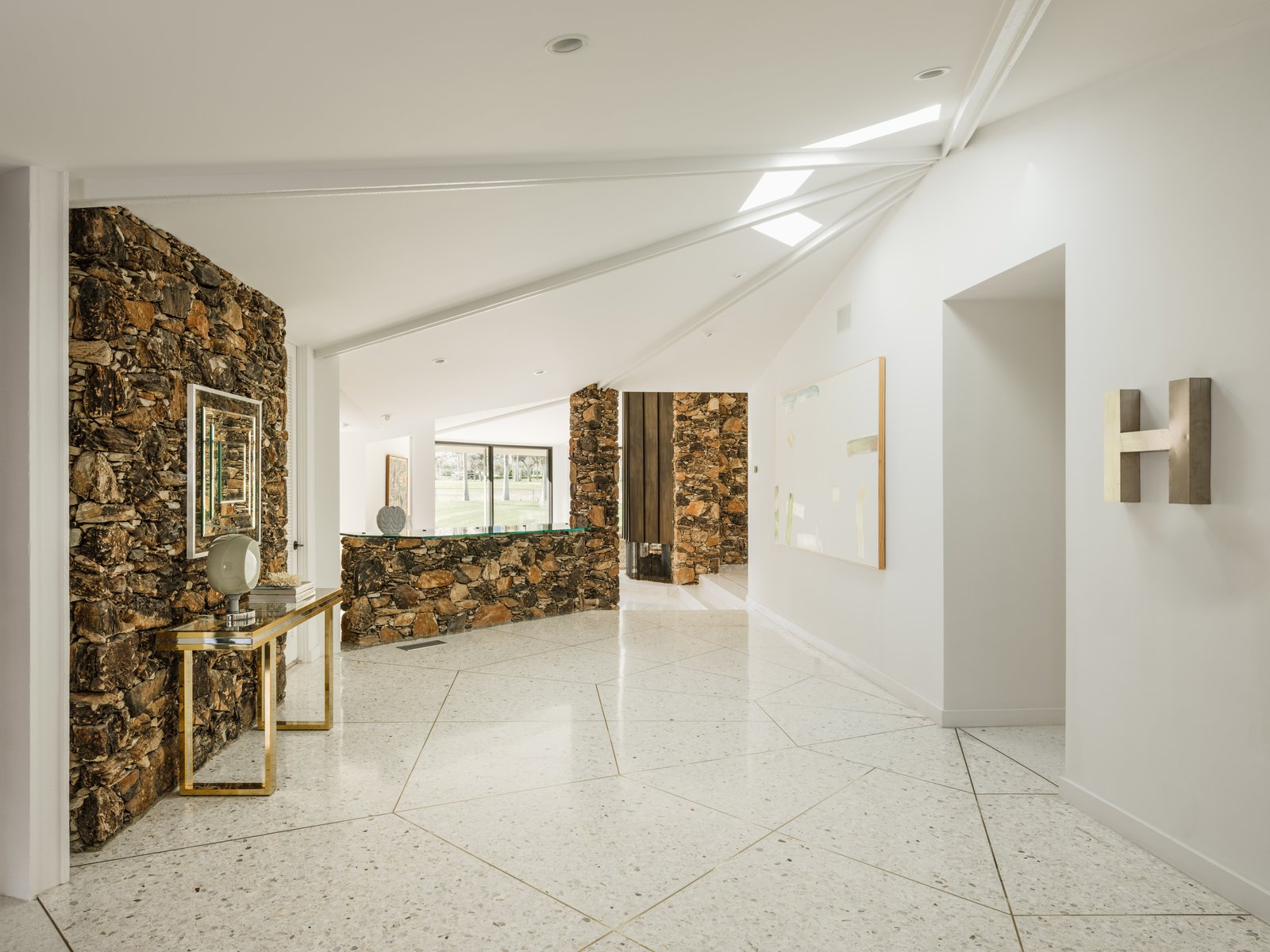 Hallway and Terrazzo Floor Another view of the entry showcasing the interior pod-like design.  Photo 4 of 19 in Own William Krisel's Palm Springs Pod House For $2.5M