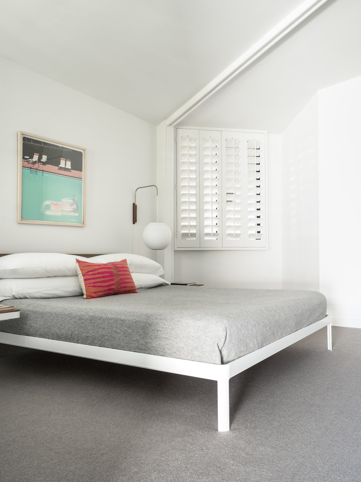 Bedroom, Carpet Floor, Night Stands, Bed, and Wall Lighting One of the bedrooms.  Photo 12 of 19 in Own William Krisel's Palm Springs Pod House For $2.5M