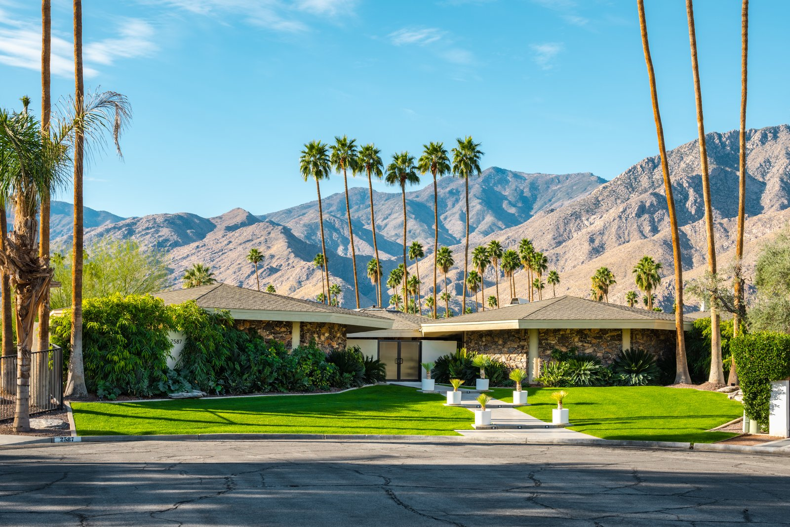 Exterior, Shingles Roof Material, House Building Type, Mid-Century Building Type, and Stone Siding Material  Photos from Own William Krisel's Palm Springs Pod House For $2.5M