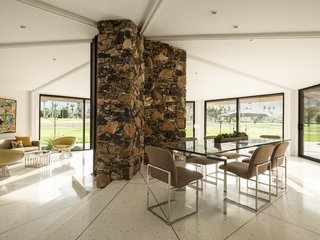 Own William Krisel's Palm Springs Pod House For $2.5M - Photo 5 of 18 - A view of the open dining and living space