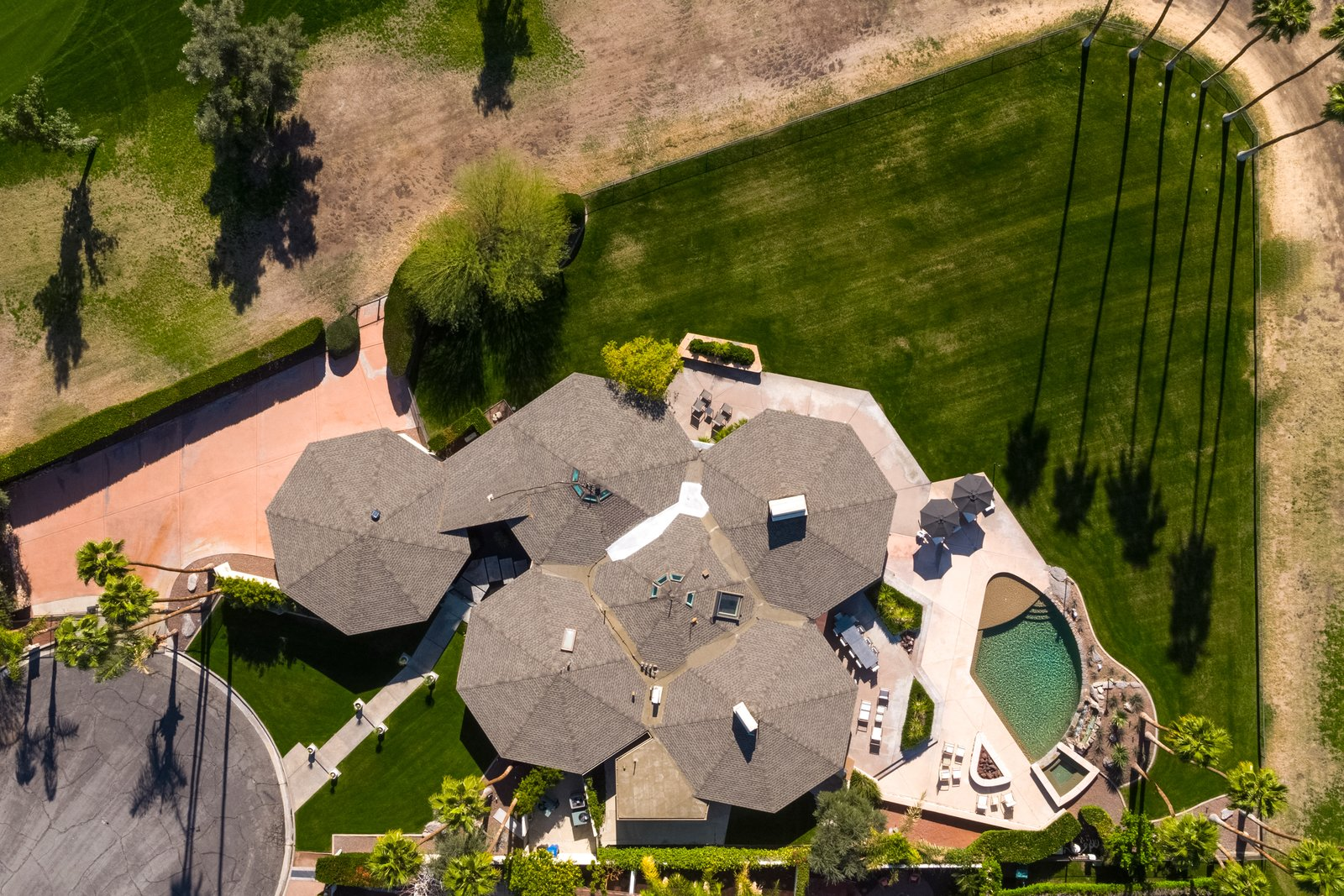 Exterior, Shingles Roof Material, House Building Type, and Mid-Century Building Type An arial view of the property clearly illustrates the five attached pods.  Photo 17 of 19 in Own William Krisel's Palm Springs Pod House For $2.5M