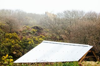 Go Off The Grid With These Remote Rental Cabins in Cornwall - Photo 12 of 12 - A view of the Kudhva rooflines against the Cornish countryside.
