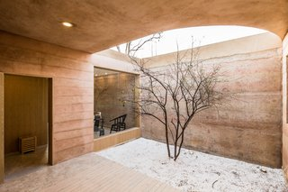 Smaller courtyards connect the southern-facing volumes of the home.