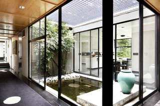 The interior courtyard and pond is a contemplative outdoor space.
