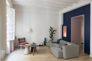 The living area is now nice and bright, and outfitted with a careful selection of furniture, such as a Mags sofa by HAY and a Roll Club Chair from Kettal.
