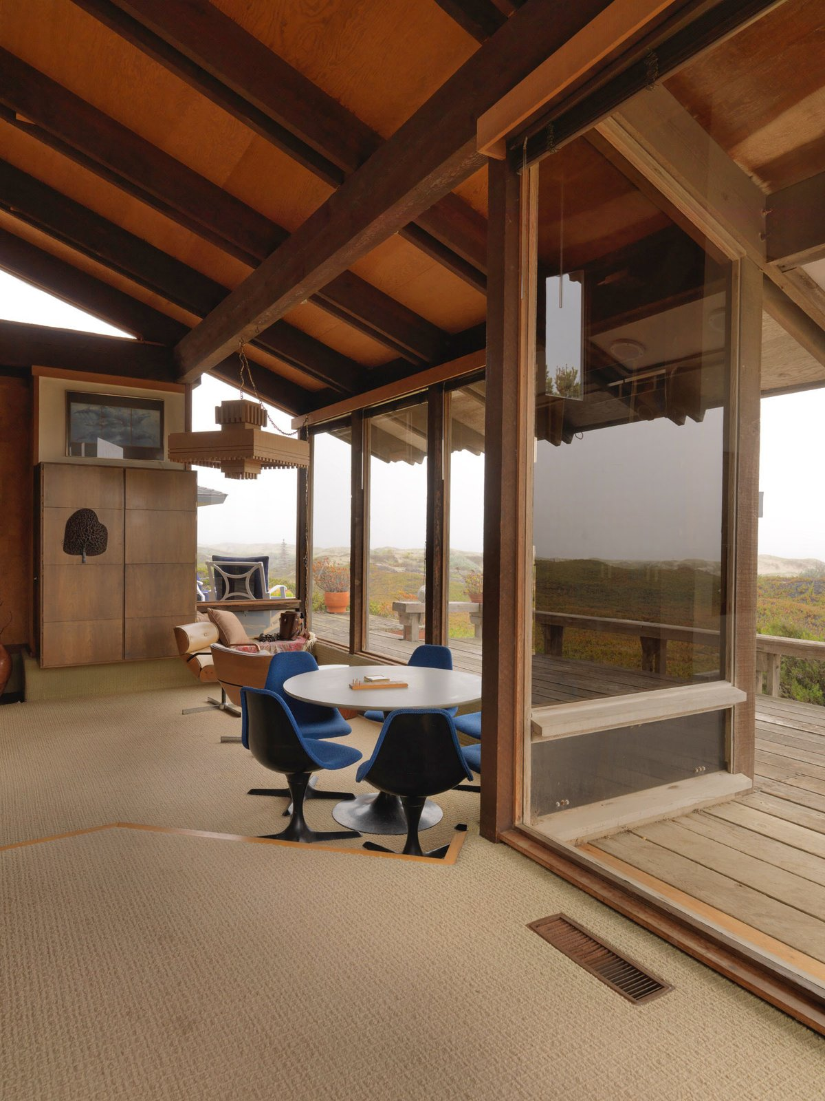 Dining, Chair, Carpet, Pendant, Table, and Storage A  Best Dining Pendant Carpet Photos from A Contemporary Beach Retreat on California's Central Coast Asks $2.3M