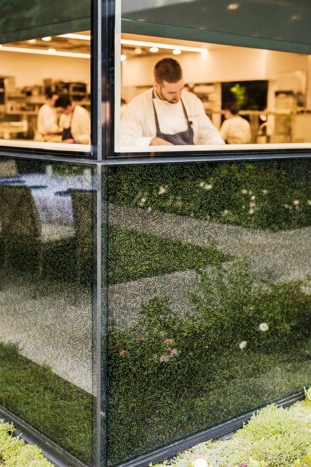 Up close, the frit reveals a dense composition of layered, swooping curves, evocative of the motions of chefs' hands at work.  Photo 7 of 12 in A Look Inside The French Laundry's Stunning $10M Renovation
