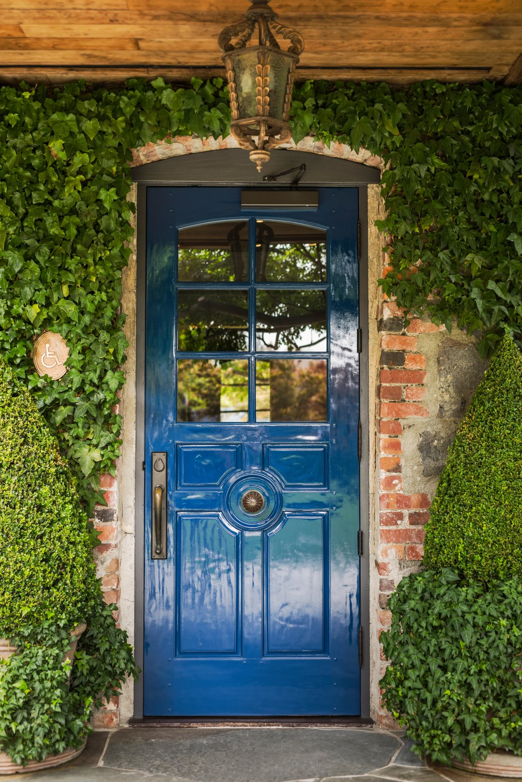 Doors, Wood, Swing Door Type, and Exterior The French Laundry's iconic blue door.  Photo 12 of 12 in A Look Inside The French Laundry's Stunning $10M Renovation