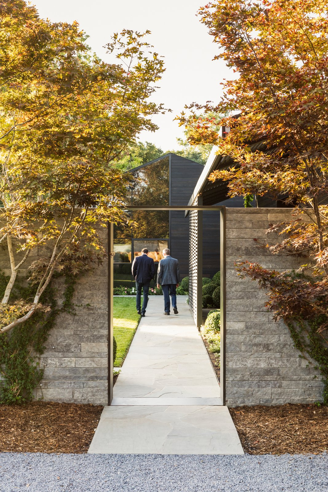 Exterior, Wood Siding Material, Stone Siding Material, and Glass Siding Material Arriving at The French Laundry, guests now begin their experience through a sequence of new garden spaces.  Photo 2 of 12 in A Look Inside The French Laundry's Stunning $10M Renovation