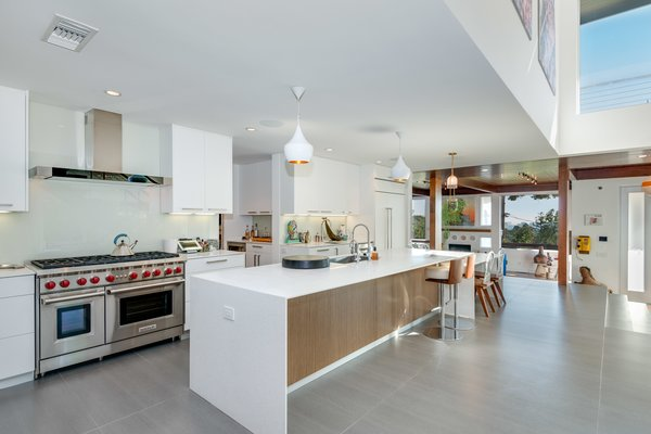 The updated open kitchen features state-of-the-art appliances from Sub Zero and Wolf, and Caesarstone countertops.