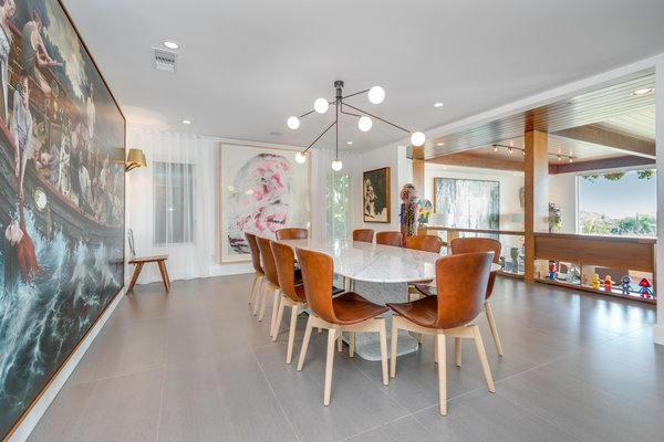 The dining area overlooks the sunken living room and benefits from natural light.