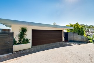 The facade offers a classic, streamlined midcentury profile. The property has been fully updated and is a Full Creston smart home.