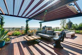 The cantilevered Managris wood roof deck also features anEcosmart fireplace and built-in heaters.