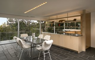 The kitchen opens to the dining area and living room.