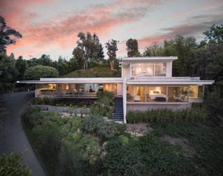 Nestled in a private, half-acre drive, the home enjoys expansive westward views to the ocean.