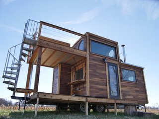 "The ""Honey on the Rock"" from tiny home maker Carpenter Owl (who specializes in custom projects) is their ""most ambitious build to date."" Originally created as a vacation home, this dwelling has fun features such as a spiral staircase, two decks, and even enough space for a king size bed. This home starts at $85,000."