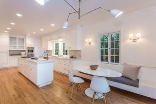 The bright and airy updated kitchen is now state of the art and includes a cozy breakfast nook.