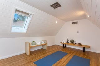 The upstairs loft is currently used as a yoga practice space.