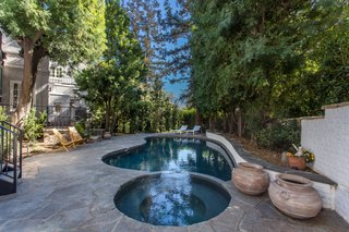 The pool and hot tub complete the private backyard.