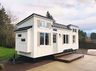 The recently completed Coastal Craftsman from Oregon-based Handcrafted Movement is now for sale and priced at $72,500. Built on a 28' x 8.5' triple axel Iron Eagle PAD trailer, the minimalist interior includes a lofted sleeping area and a sofa that transforms into a bed for an additional sleeping area.