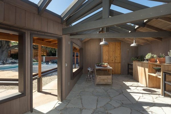 With original steel-framed windows, beamed ceilings, warm wood-paneled walls, and  a gracious floor plan it makes for a wonderful entertaining space