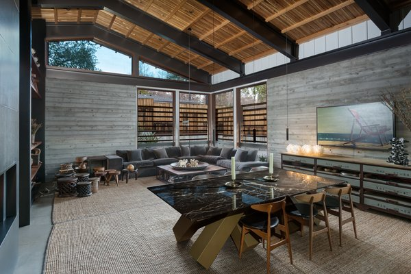Thetongue-and-groove cedar ceiling is an authentic midcentury touch, while clerestory windows help keep the living area bright and airy.