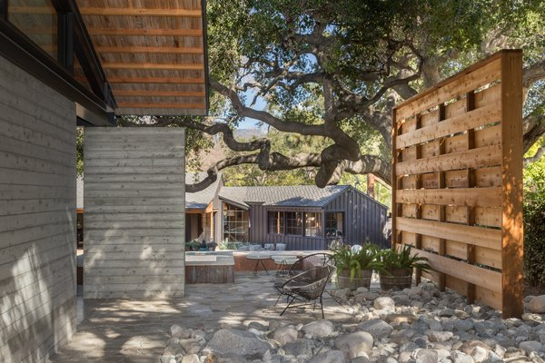 An original 1957 California Ranch by Kemper/Nomland has been painted black and transformed into a pool/guest house.