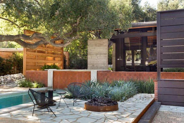 The outdoor space also includes a fire pit.