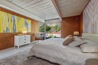 The master bedroom overlooks the backyard.