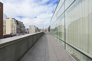 Gorgeous city views are consistently available, thanks to the terrace that wraps around the perimeter of the unit.