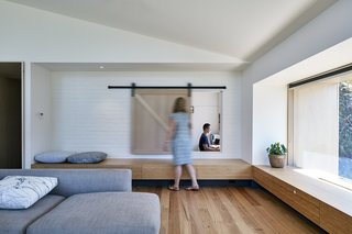 A low wooden bench running along both sides of the extension is both functional and attractive.
