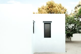 The home's whitewashed exterior references the widely acclaimed Greek island architecture.