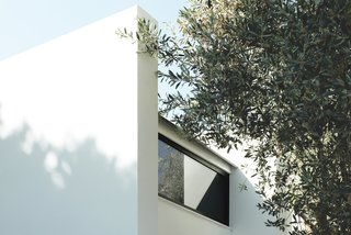 Rent This Modular Micro Cabin For Your Next Grecian Getaway - Photo 2 of 13 - Modular concrete panels make up the walls, while clerestory windows help keep the interiors bright and airy.