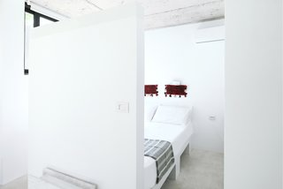 Rent This Modular Micro Cabin For Your Next Grecian Getaway - Photo 5 of 13 - The crisp white kitchen opens to the bedroom.