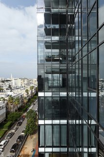 An up-close look at the steel and glass exterior of the modern tower in downtown Tel Aviv.