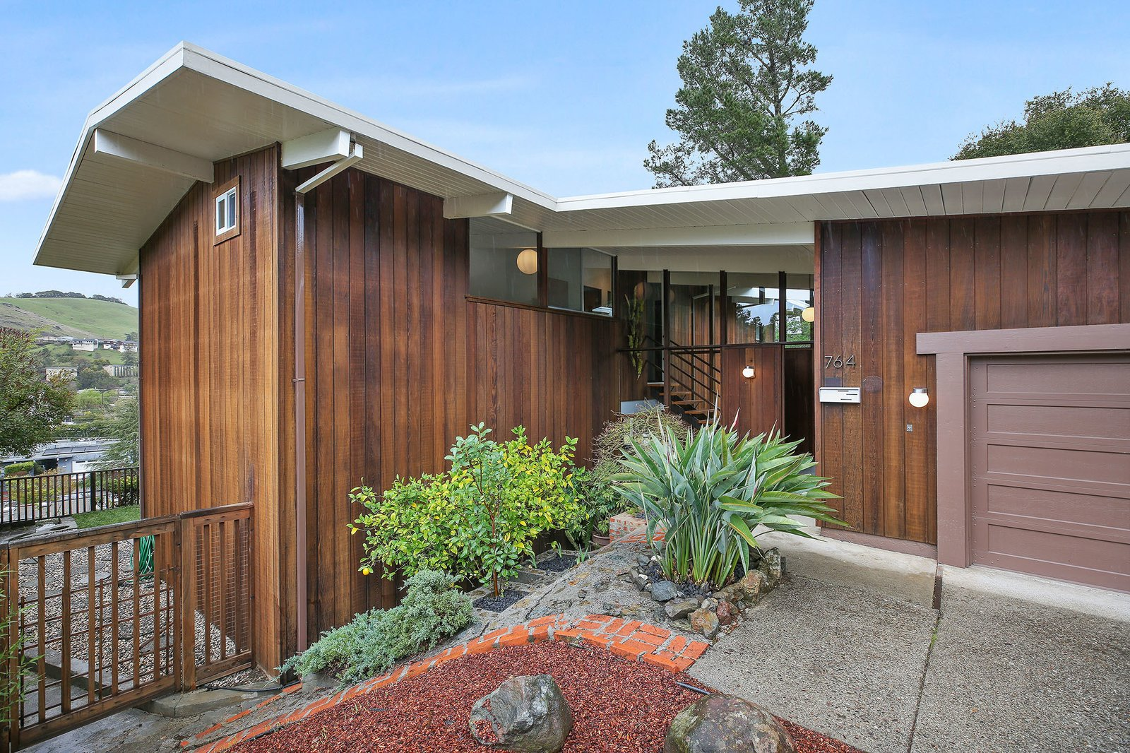 Exterior, House Building Type, Mid-Century Building Type, Flat RoofLine, and Wood Siding Material  Photo 1 of 15 in This Rare Two-Story Eichler Has Just Been Listed For $1.35M