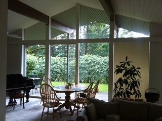 Before and After: A Midcentury Lakeside Home Receives a Stunning New Look - Photo 5 of 11 - The living/dining area before.