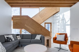 The stylish staircase provides a strong focus for the open-plan interior, and was constructed out of fir plywood by Duerksen himself.