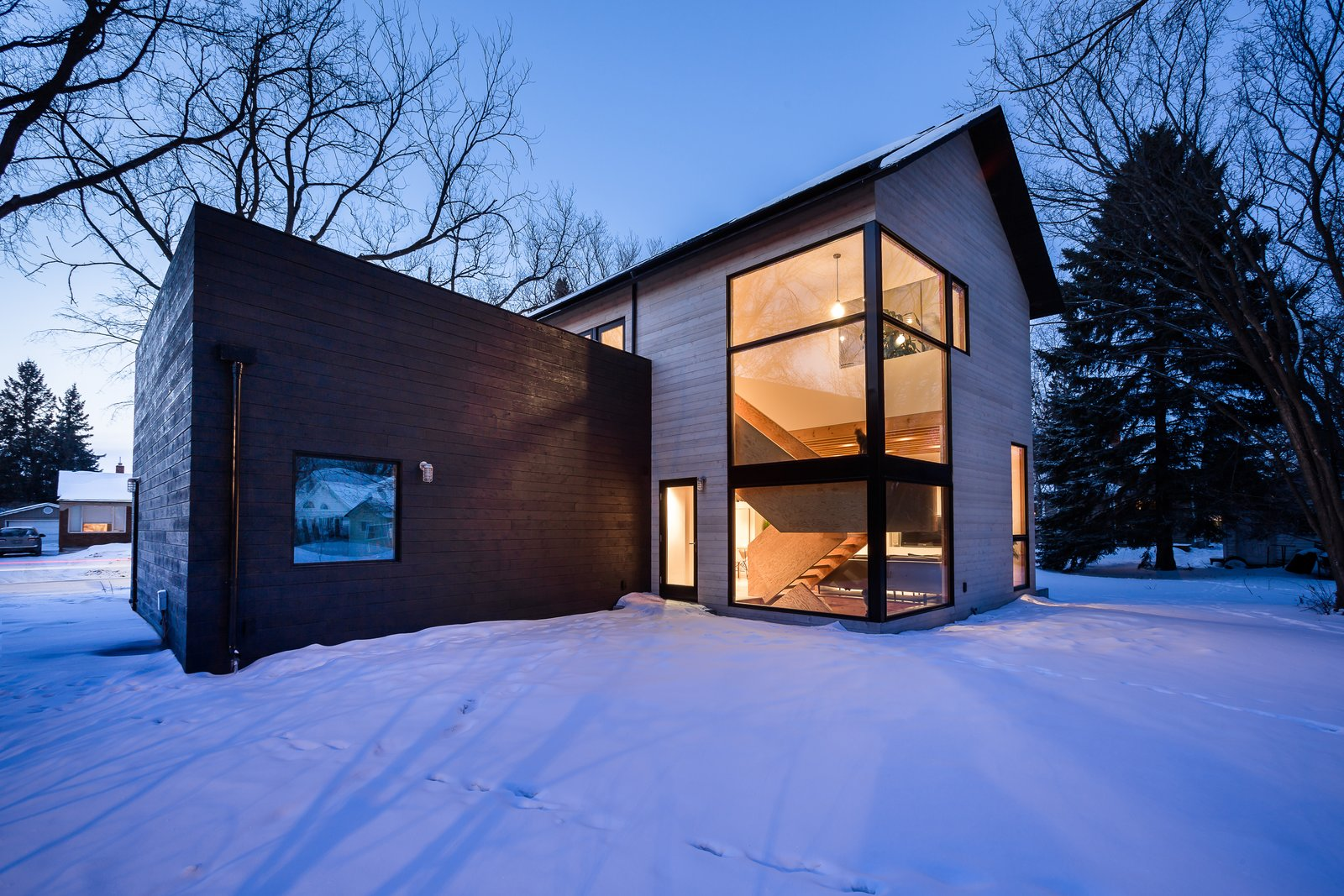 Exterior, House Building Type, Wood Siding Material, Gable RoofLine, and Flat RoofLine  Photo 1 of 13 in An Intern Architect Builds a Home For His Growing Family on a Strict Budget