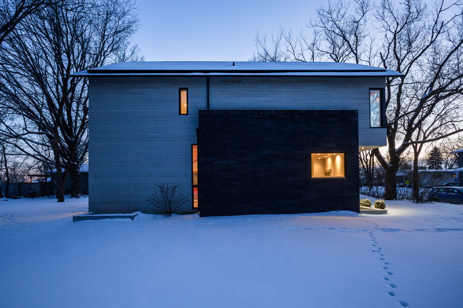 Exterior, House Building Type, Wood Siding Material, Gable RoofLine, and Flat RoofLine T  Photo 3 of 13 in An Intern Architect Builds a Home For His Growing Family on a Strict Budget