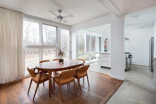 Wood flooring delineates the dining room area.